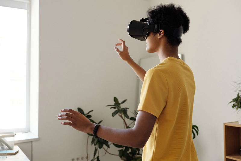 Canva - Boy in Yellow T-shirt Using Vr Headset